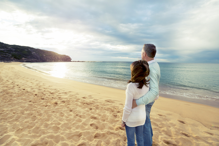 Happy mature couple looking at the sunrise